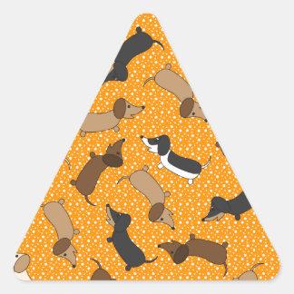 Dancing Dachshunds (Orange) Triangle Sticker