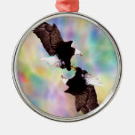 Dancing eagles round metal christmas ornament