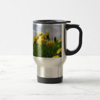 Dandelion meadow with sky travel mug