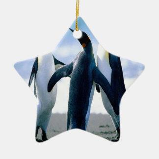 Danza del pingüino adorno navideño de cerámica en forma de estrella