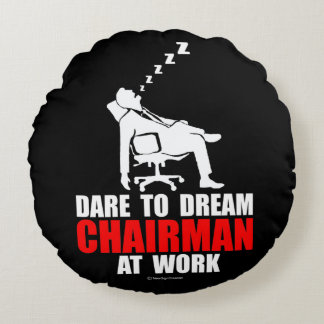 Dare to dream chairman at work round pillow