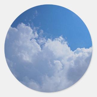 Dark clouds, blue sky and bright sun classic round sticker