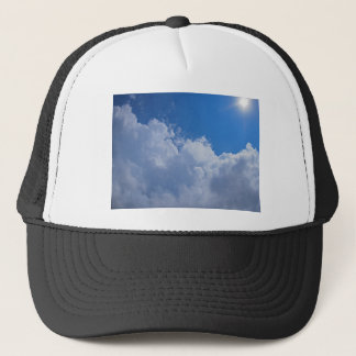 Dark clouds, blue sky and bright sun trucker hat