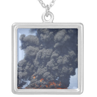 Dark clouds of smoke and fire emerge 2 silver plated necklace