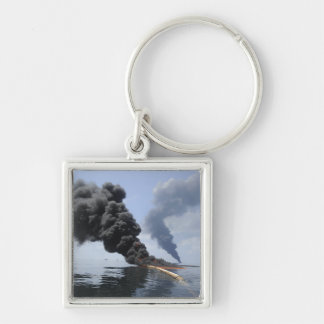 Dark clouds of smoke and fire emerge 3 Silver-Colored square keychain