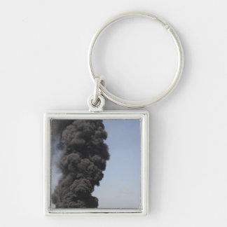 Dark clouds of smoke and fire emerge keychain