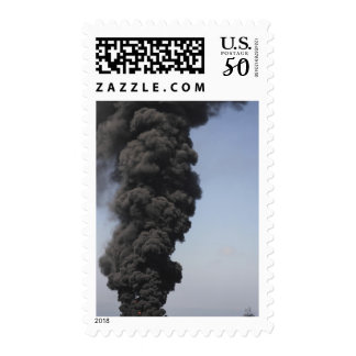 Dark clouds of smoke and fire emerge postage