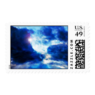 Dark cloudy Sky with bright light Postage Stamp