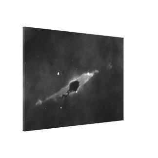 Dark Globule and Stellar Jet in the Carina Nebula Canvas Print