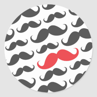 Dark gray mustache pattern with one red moustache classic round sticker