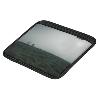 Dark green grass and gray sky sleeve for iPads