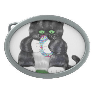 Dark Grey Tiger Kitten Holds Tightly to an Easter Oval Belt Buckle
