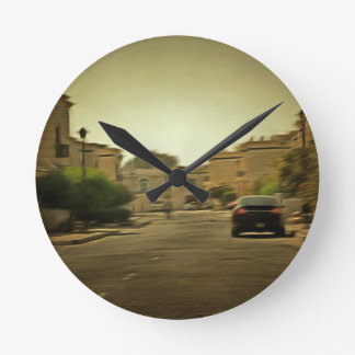 Dark hues in a residential neighborhood with vill round wallclock