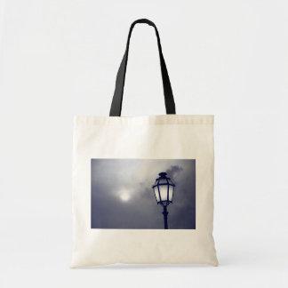 Dark light tote bags