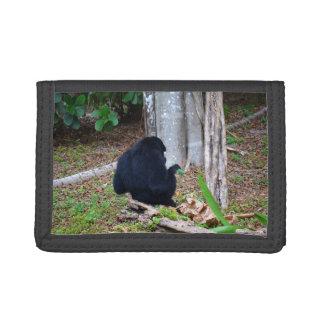 dark monkey in grass back image wallets