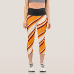 [ Thumbnail: Dark Orange, Beige, and Maroon Pattern Leggings ]
