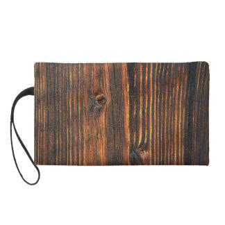 Dark orange wooden wall texture wristlet
