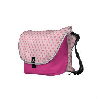 Dark pink polka dots and stripes on light pink messenger bag