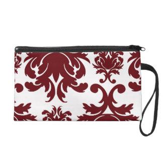 dark red damask pattern on white wristlet purse