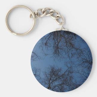 Dark silhouetted trees keychain