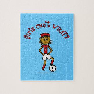 Dark Soccer Girl in Red Uniform Jigsaw Puzzle