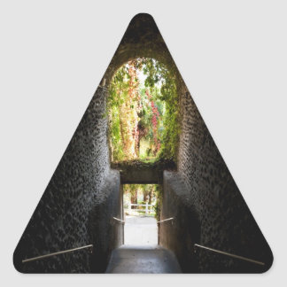 Dark stairs with a stone archway that going down triangle sticker