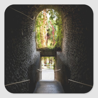 Dark stairs with a stone archway that going down sticker