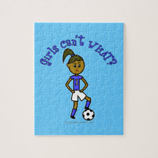 Dark Womens Soccer in Blue Uniform Jigsaw Puzzle