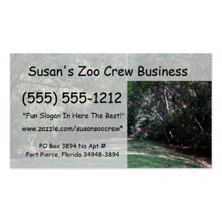 Darker green woods with grass path middle business card