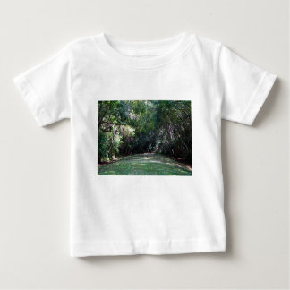 Darker green woods with grass path middle infant t-shirt