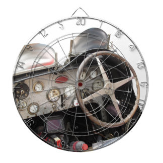 Dashboard and steering wheel of classic sport car dartboard with darts