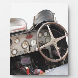 Dashboard and steering wheel of classic sport car plaque