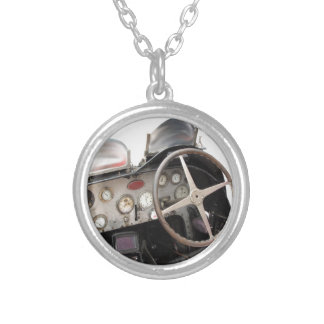 Dashboard and steering wheel of classic sport car round pendant necklace