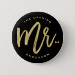 "Dashing Mr Gold Brush Script Bow Tie Wedding Party Pinback Button<br><div class=""desc"">The dashing Mr. 'custom name' gold brushed calligraphy script bow tie wedding / bridal / bachelor party button. This modern design features a classy and trendy gold 'Mr.' brushed calligraphy script with a stylish bow tie accent on a black background. The background color can be changed to any color of...</div>"