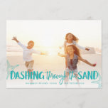 "Dashing Through the Sand | Holiday Photo Card<br><div class=""desc"">Perfect for those living in tropical climes, or for sharing a favorite beach vacation photo, our coastal chic holiday photo card features ""Dashing Through the Sand"" as a vibrant turquoise text overlay adorned with starfish illustrations. Personalize with your names and custom greeting (shown with ""warmest wishes"") along the bottom. Cards...</div>"
