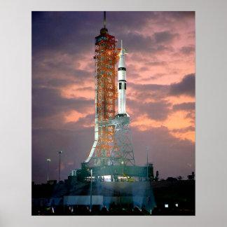 Dawn breaks behind ASTP Saturn IB CDDT Poster
