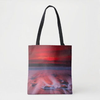 Dawn Over The Stormy Sea Tote Bag