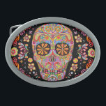 "Day of the Dead Sugar Skull Belt Buckle<br><div class=""desc"">This Day of the Dead Sugar Skull Belt Buckle features a colorful psychedelic sugar skull calavera celebrating Mexico&#39;s Day of the Dead,  or Dia de los Muertos. The funky design for this Sugar Skull Day of the Dead Belt Buckle is based on the artwork of Thaneeya McArdle.</div>"