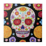 "Day of the Dead Sugar Skull Ceramic Tile<br><div class=""desc"">This Day of the Dead Sugar Skull Ceramic Tile features a colorful psychedelic calavera surrounded by marigolds and other flowers, celebrating Mexico&#39;s Day of the Dead, or Dia de los Muertos. The funky design for this Day of the Dead Sugar Skull Ceramic Tile is based on the artwork of Thaneeya...</div>"