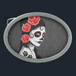 """Day of the Dead Sugar Skull Girl - Grey Belt Buckle<br><div class=""""desc"""">This Day of the Dead inspired design features a beautiful woman with sugar skull patterns on her face. Three roses appear in her jet black hair with two more roses tattooed on her arm. The girl is standing sideways with her head turned slightly towards the viewer. Her pure white skin...</div>"""