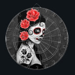 "Day of the Dead Sugar Skull Girl - Grey Dartboard<br><div class=""desc"">This Day of the Dead inspired design features a beautiful woman with sugar skull patterns on her face. Three roses appear in her jet black hair with two more roses tattooed on her arm. The girl is standing sideways with her head turned slightly towards the viewer. Her pure white skin...</div>"