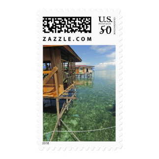 Dayak Lau living on boats and houses on stilts Postage
