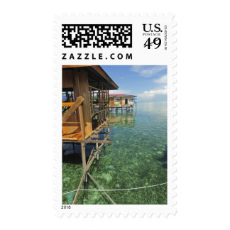 Dayak Lau living on boats and houses on stilts Stamps