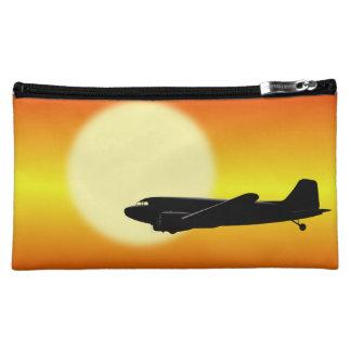 DC-3 passing sun. Cosmetics Bags
