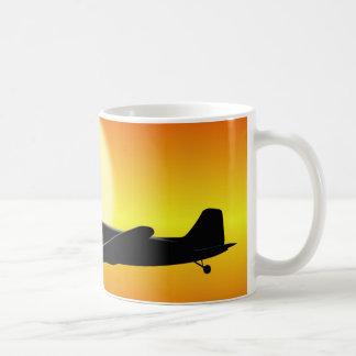 DC-3 passing sun. Coffee Mug
