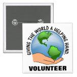 Dé a mundo una mano amiga y un voluntario pins