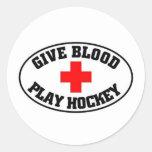 Dé el hockey del juego de la sangre pegatinas redondas