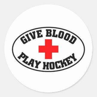 Dé el hockey del juego de la sangre pegatina redonda