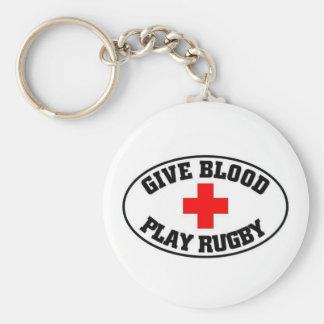 Dé el rugbi del juego de la sangre llavero redondo tipo pin