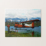 """De Havilland Beaver Floatplane Jigsaw Puzzle<br><div class=""""desc"""">A bush pilot stands near his de Havilland Canada DHC-2 Beaver floatplane on the shore of a lake in the far north; mountains and trees are in the distance.   Text reading &quot;Alaska&quot; also appears. This image was derived,  in part,  from a US Fish and Wildlife Service photo.</div>"""